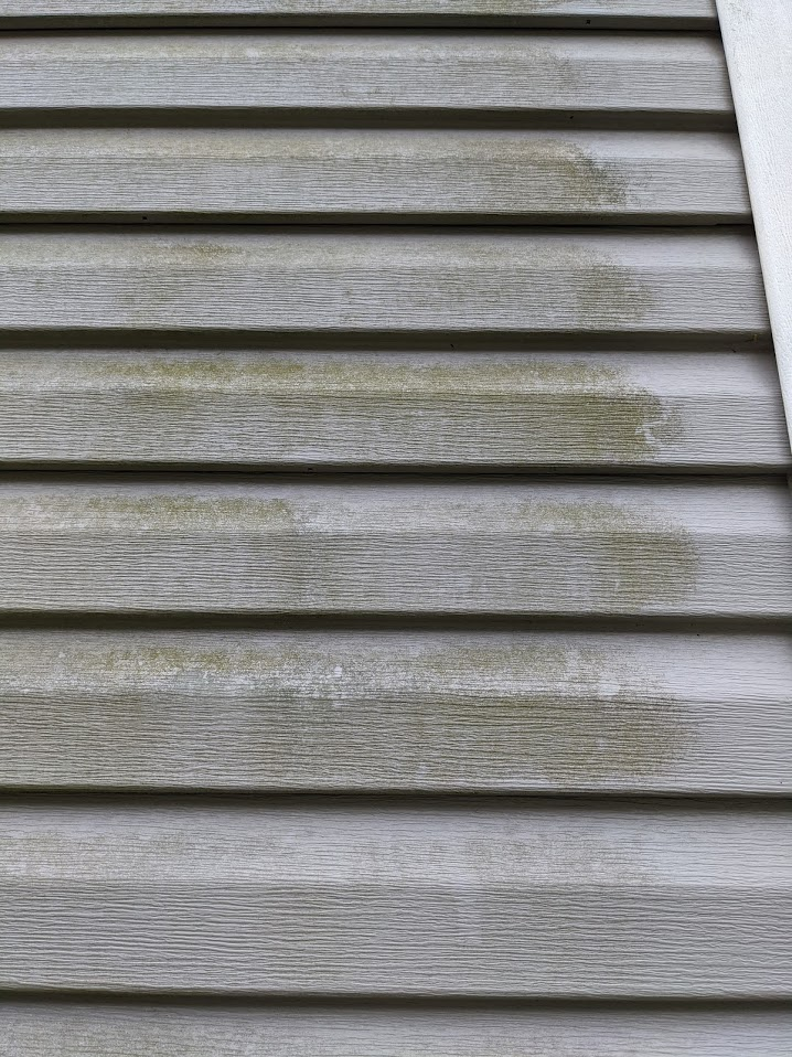 This grey colered vinyl siding that needs to be cleaned