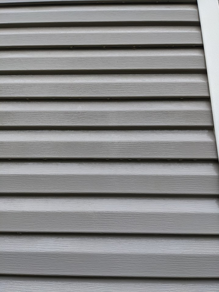 This is a picture of grey siding after we cleaned it in Powell Tn.