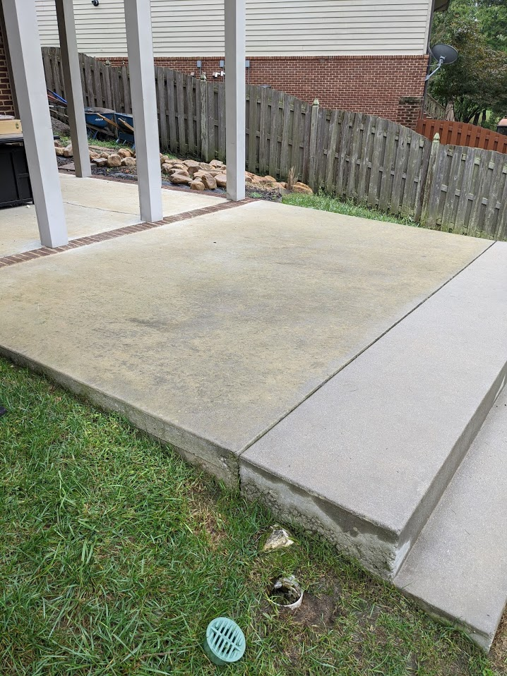 concrete patio in backyard covered in algae making it slippery to walk on