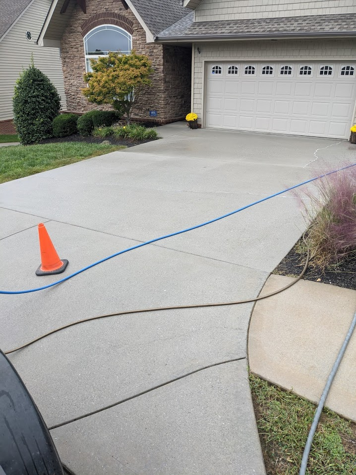 Clean driveway after pressure washing and applying a post-treat