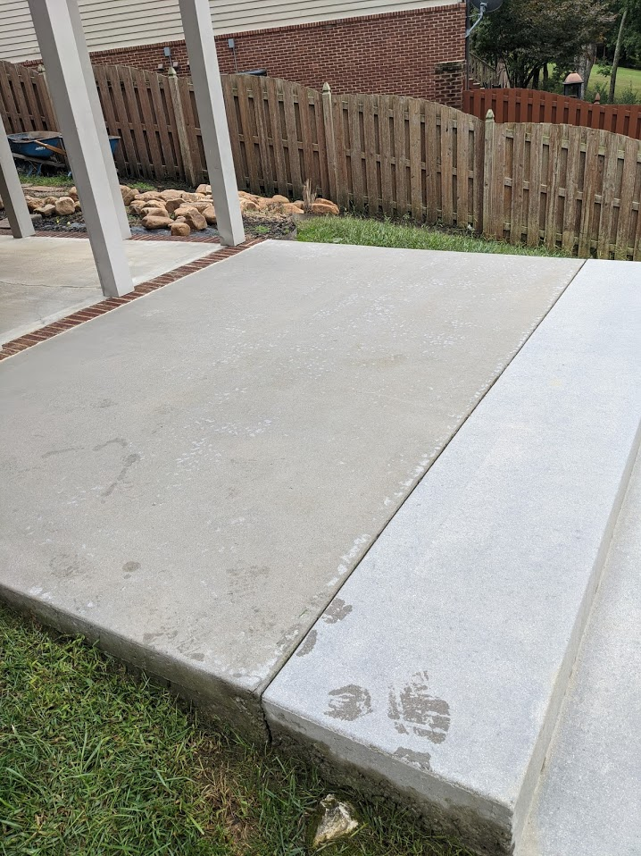 Concrete patio in backyard has been pressure washed