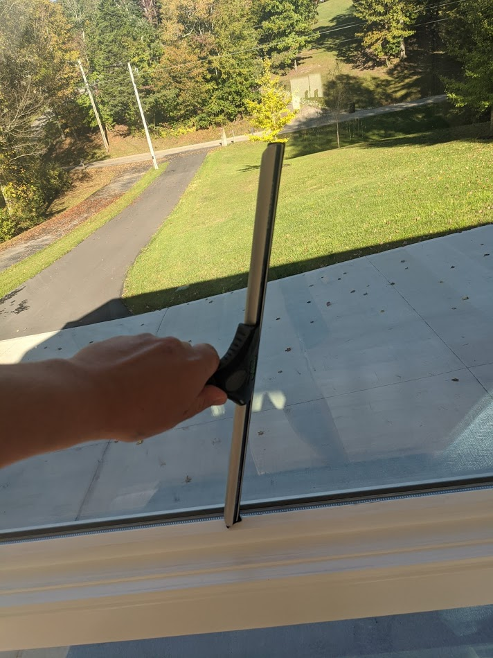 Drying window using a squeegee