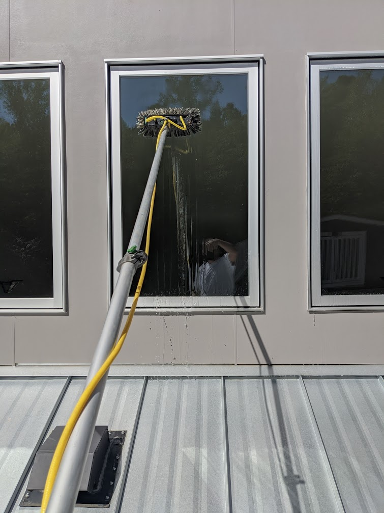 Cleaning high windows with no ladder