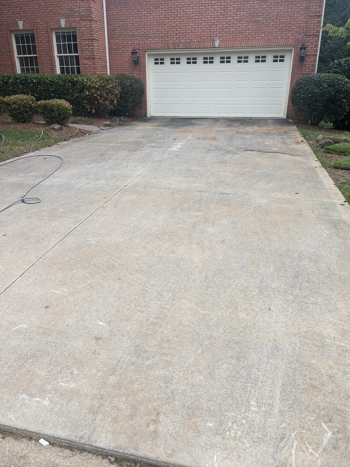 Dirty Driveway covered in dirt, mold and algae the needs to be cleaned