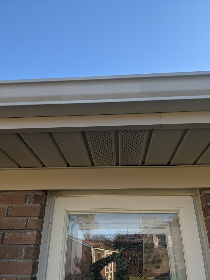 pressure washed gutter and soffit cleaned to remove dirt and algae