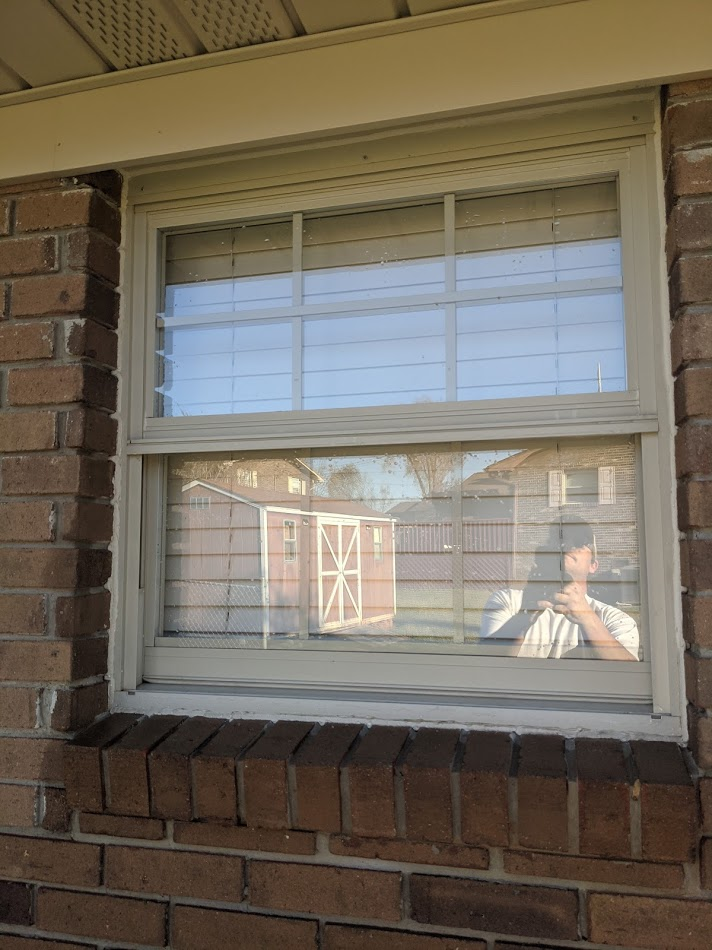 Exterior windows that have been cleaned after a pressure washing that are now spotless